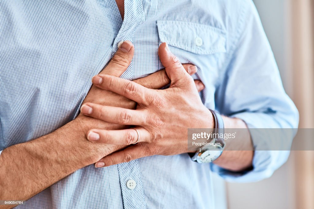 Chest pains are never a good sign : Stock Photo