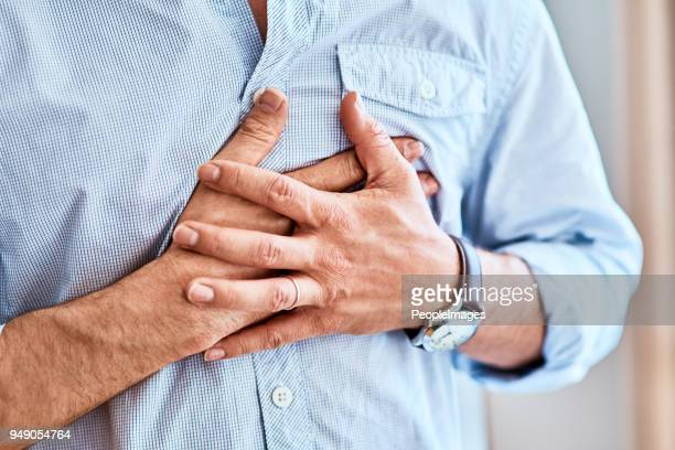 chest pains are never a good sign - problems stock pictures, royalty-free photos & images