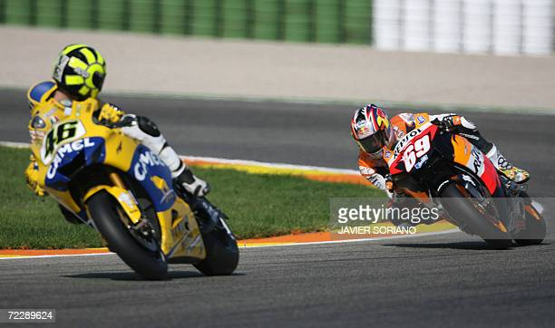 Italian Valentino Rossi is followed by American Nicky Hayden during a practice session at the Ricardo Tormo racetrack in Cheste near Valencia 28...