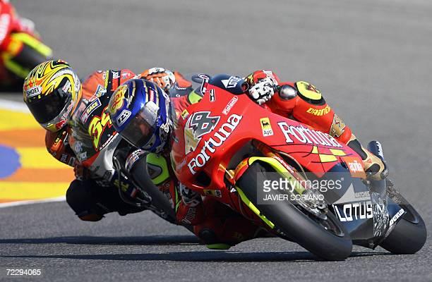 Spain's Jorge Lorenzo powers his aprilia followed by Italian Andrea Dovizioso during the 250cc. Race at the Valencia Grand Prix at the Ricardo Tormo...