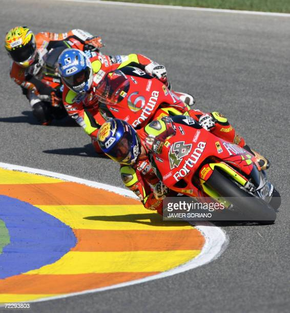 Spain's Jorge Lorenzo takes a corner ahead of Aprilla partner Alex Debon during the 250cc race at the Valencia Grand Prix at the Ricardo Tormo...
