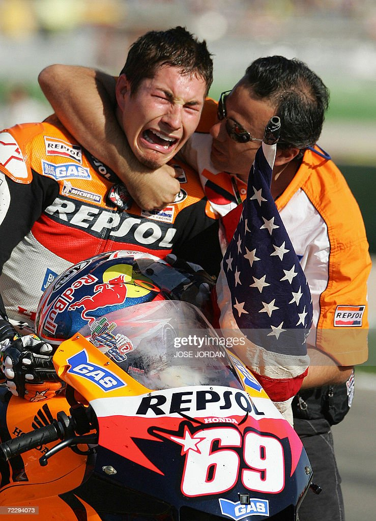US Nicky Hayden bursts into tears after winning the 2006 Moto GP championship at the end of season Valencia Grand Prix at the Ricardo Tormo racetrack in Cheste, 29 October 2006. Australia's Troy Bayliss won the race with Italy's Loris Capirossi in second and US Nicky Hayden in third.