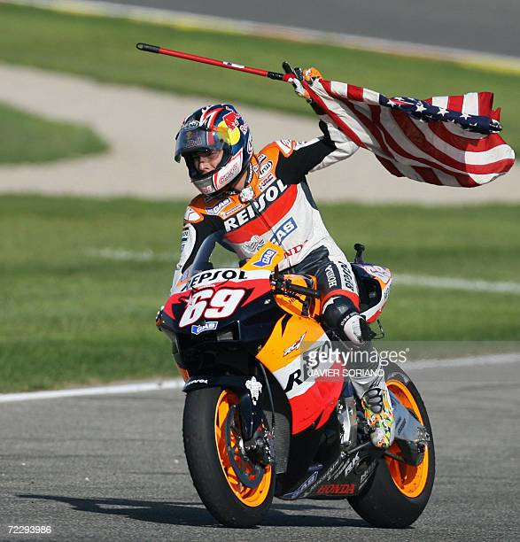 US Nicky Hayden celebrates after winning the 2006 Moto GP championship after the Valencia Grand Prix at the Ricardo Tormo racetrack in Cheste 29...