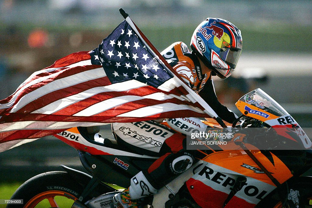 US Nicky Hayden celebrates after winning the 2006 Moto GP championship after the Valencia Grand Prix at the Ricardo Tormo racetrack in Cheste, 29 October 2006. Australia's Troy Bayliss won the race with Italy's Loris Capirossi in second and US Nicky Hayden in third.