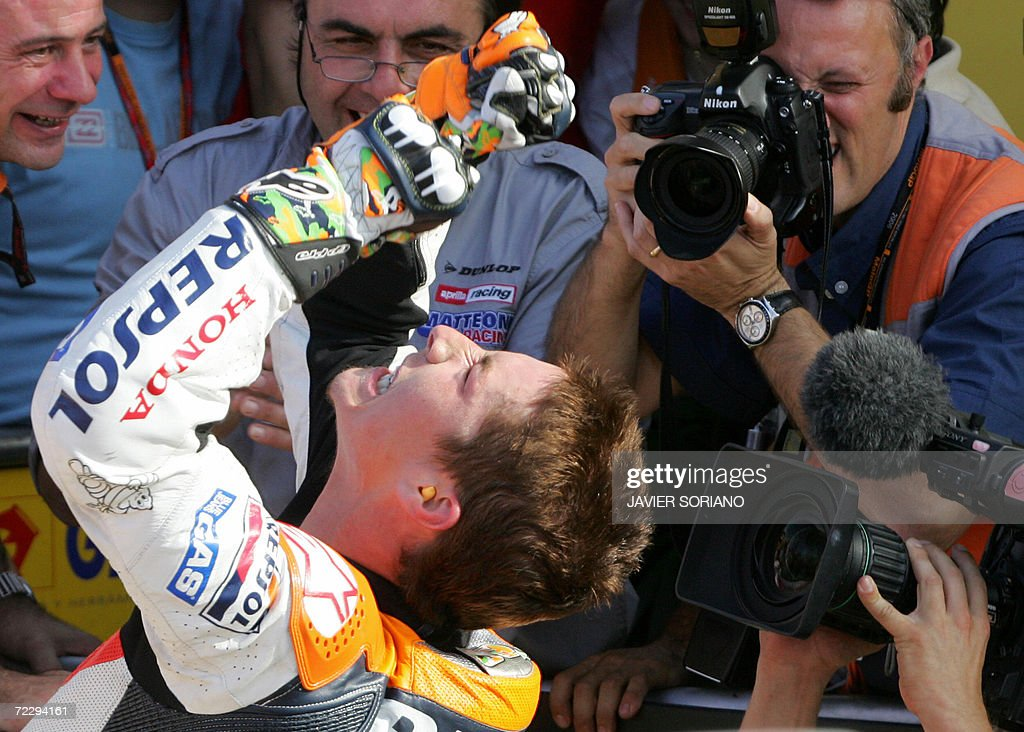 US Nicky Hayden celebrates after winning the 2006 Moto GP championship at the end of season Valencia Grand Prix at the Ricardo Tormo racetrack in Cheste, 29 October 2006. Australia's Troy Bayliss won the race with Italy's Loris Capirossi in second and US Nicky Hayden in third.