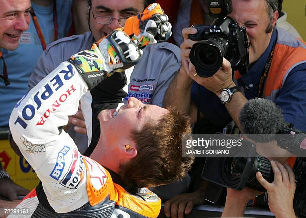 US Nicky Hayden celebrates after winning the 2006 Moto GP championship at the end of season Valencia Grand Prix at the Ricardo Tormo racetrack in...