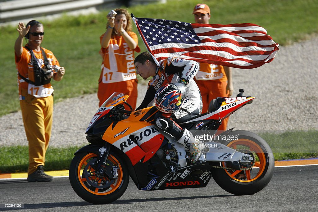 US Nicky Hayden does a victory lap after : News Photo