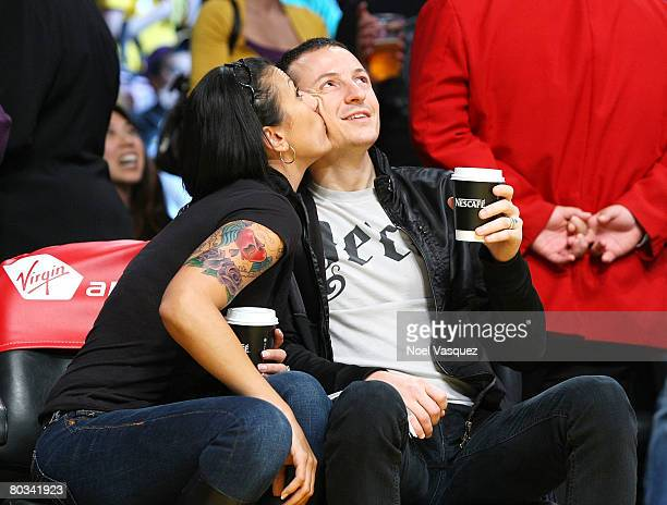Chester Bennington and his wife Talinda Bentley attend the Los Angeles Lakers vs Seattle Supersonics at the Staples Center on March 21 2008 in Los...