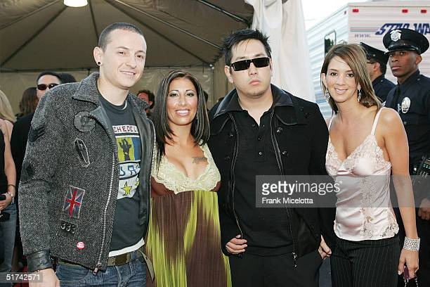 Chester Bennington and Joe Hahn of Linkin Park pose with their guests at the 32nd Annual American Music Awards at the Shrine Auditorium November 14...