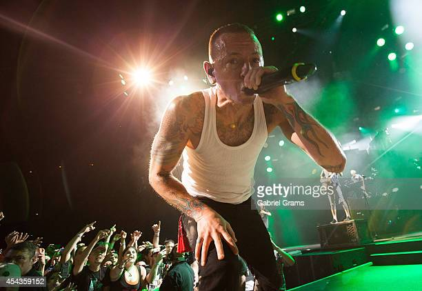 Chester Bennington of Linkin Park performs at Tinley Park on August 29 2014 in Chicago Illinois