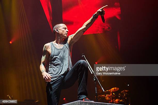 Chester Bennington of Linkin Park performs on stage at Phones4u Arena on November 22 2014 in Manchester United Kingdom