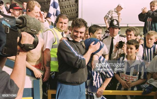 Chester City manager Ian Atkins consoles a fan at the end of the game after Chester's relegation to the Nationwide Conference