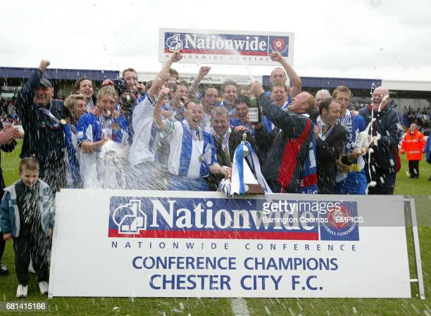 Chester City's players and manager Mark Wright celebrate their promotion to the 3rd division against Scarborough