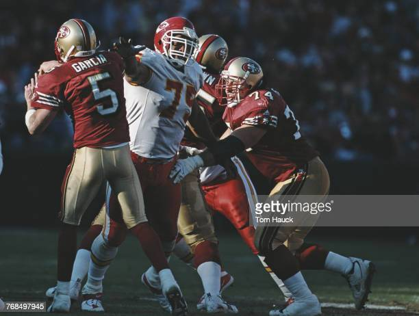 Chester McGlockton Defensive End for the Kansas City Chiefs attempts to sack Jeff Garcia Quarterback for the San Francisco 49ers during their...