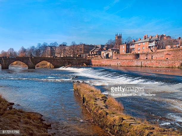 chester, old dee bridge and roman walls - fortified wall stock photos and pictures