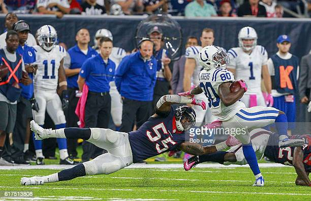 Chester Rogers of the Indianapolis Colts attempts to get around Benardrick McKinney of the Houston Texans and Johnathan Joseph at NRG Stadium on...