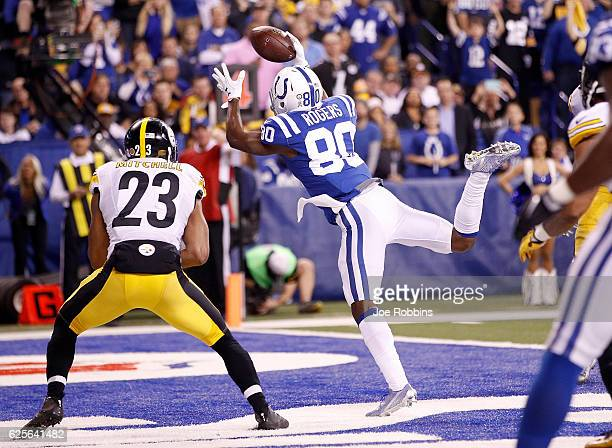 Chester Rogers of the Indianapolis Colts attempts to make a catch while being guarded by Mike Mitchell of the Pittsburgh Steelers during the second...