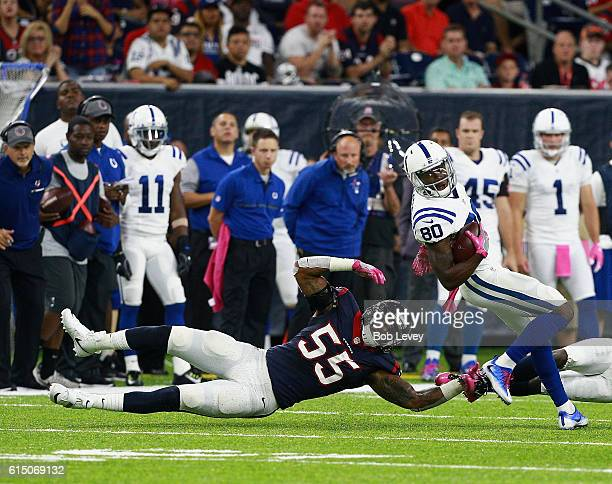 Chester Rogers of the Indianapolis Colts breaks the tackle attempt of Benardrick McKinney of the Houston Texans in the second quarter at NRG Stadium...