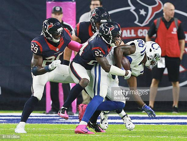 Chester Rogers of the Indianapolis Colts is tackled by Johnathan Joseph of the Houston Texans and Andre Hal at NRG Stadium on October 16 2016 in...