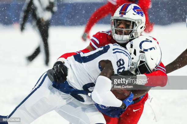 Chester Rogers of the Indianapolis Colts is tackled by Micah Hyde of the Buffalo Bills during overtime on December 10 2017 at New Era Field in...