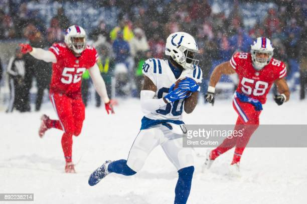 Chester Rogers of the Indianapolis Colts runs with the ball during overtime against the Buffalo Bills at New Era Field on December 10 2017 in Orchard...
