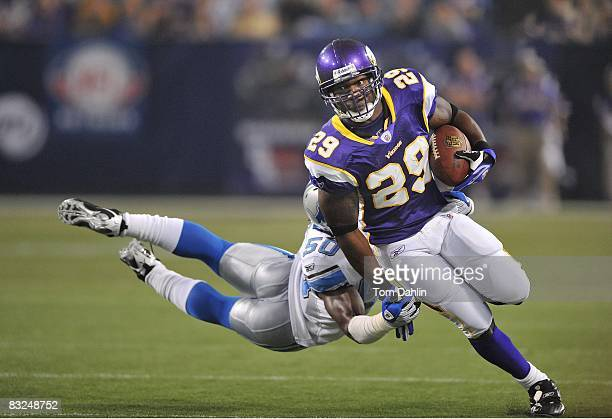 Chester Taylor of the Minnesota Vikings carries the ball during an NFL game against the Detroit Lions at the Hubert H Humphrey Metrodome October 12...