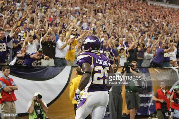 Chester Taylor of the Minnesota Vikings looks into the crowd as they cheer during the NFL game against the Carolina Panthers at the Hubert H Humphrey...