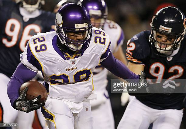 Chester Taylor of the Minnesota Vikings runs the ball in the first quarter against Hunter Hillenmeyer of the Chicago Bears at Soldier Field on...