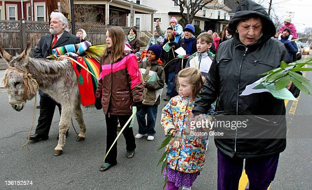 Chester the gray donkey once again led the Palm Sunday procession down College Avenue to Davis Square. Annual service is organized by several local...