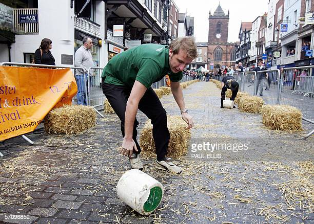 Competitors from Cheshire Stilton and Lancashire take part in the fifth annual Cheese Rolling Event in the streets of Chester in northwest England 15...