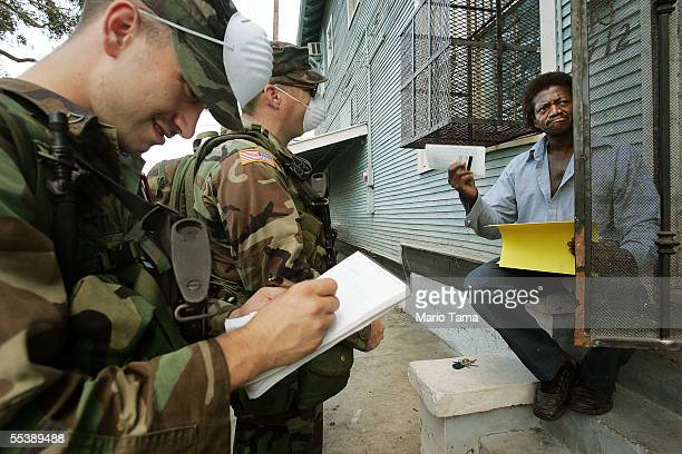 Chester Williams is interviewed by US Army National Guard soldiers from Oklahoma conducting door to door searches September 12 2005 in New Orleans...