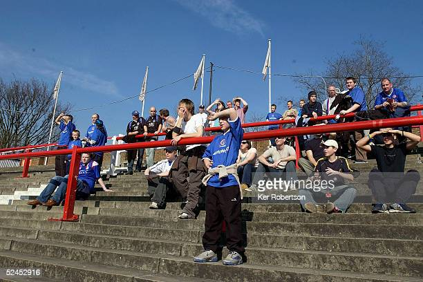 Chesterfield fans soak up the spring sunshine during the CocaCola League One match between Brentford and Chesterfield at Griffin Park on March 19...