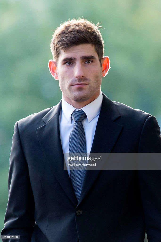 Chesterfield F.C football player Ched Evans arrives at Cardiff Crown Court where he is standing trial for rape on October 12, 2016 in Cardiff, Wales. The former Wales striker was jailed in 2012 for raping a 19-year-old woman, but had his conviction quashed by the Court of Appeal in April.
