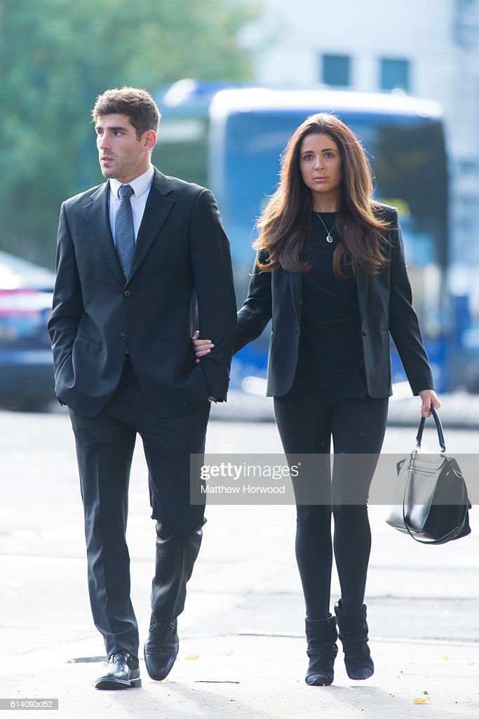 Chesterfield F.C football player Ched Evans arrives at Cardiff Crown Court with his girlfriend Natasha Massey where he is standing trial for rape on October 12, 2016 in Cardiff, Wales. The former Wales striker was jailed in 2012 for raping a 19-year-old woman, but had his conviction quashed by the Court of Appeal in April.