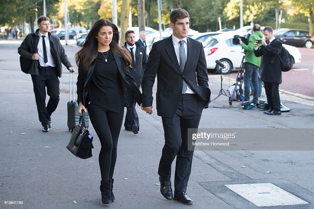 Chesterfield F.C football player Ched Evans (R) leaves Cardiff Crown Court with his girlfriend Natasha Massey where he is standing trial for rape on October 11, 2016 in Cardiff, Wales. The former Wales striker was jailed in 2012 for raping a 19-year-old woman, but had his conviction quashed by the Court of Appeal in April.