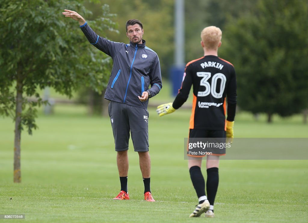 Chesterfield goalkeeper coach Mat Duke gives instructions to Dylan Parkin during the Reserve Match between Northampton Town and Chesterfield at Moulton College on August 21, 2017 in Northampton, England.