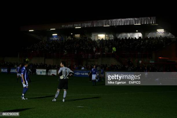 Chesterfield's Darren Currie and goalkeeper Tommy Lee in conversation after a floodlight failure during the game