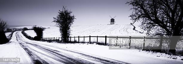chesterton windmill in snow - chesterton stock photos and pictures