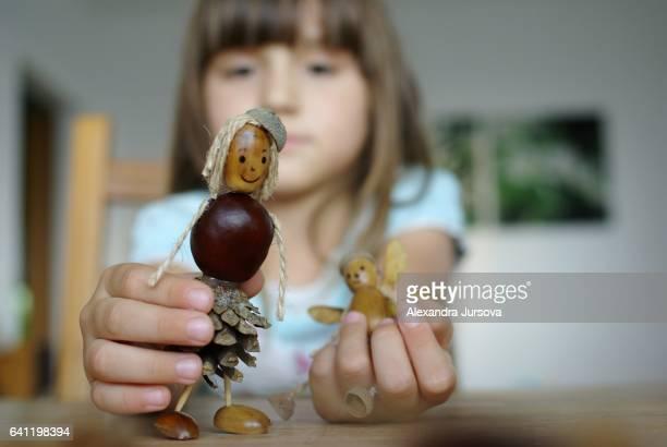 chestnut and acorn stick figures (children and creativity) - kastanie laubbaum stock-fotos und bilder