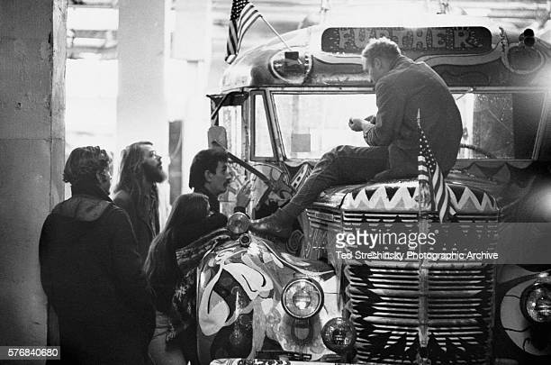 Chet Helms the operator of the Avalon Ballroom listens along with some of the Merry Pranksters to Ken Kesey author and leader of the psychedelic...