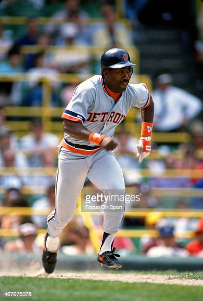 Chet Lemon of the Detroit Tigers puts the ball in play and races towards first base against the Chicago White Sox during an Major League Baseball...
