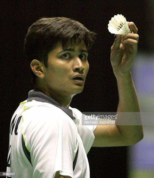 Chetan Anand of India shows the shuttle before scoring match point against Tooru Matsumoto of Japan in his first round match in the All England...