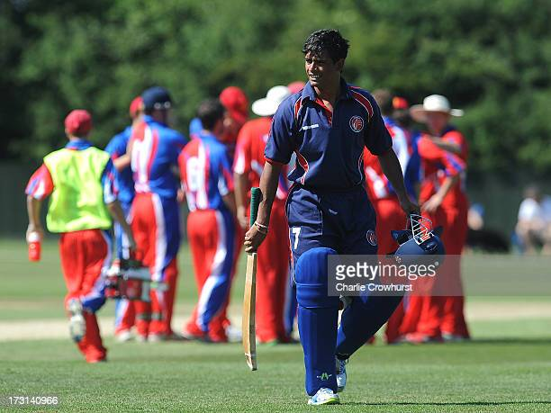 Chetan Chauhan of France walks off after being given out during the European Division 1 Championship Group B match between Jersey and France at...