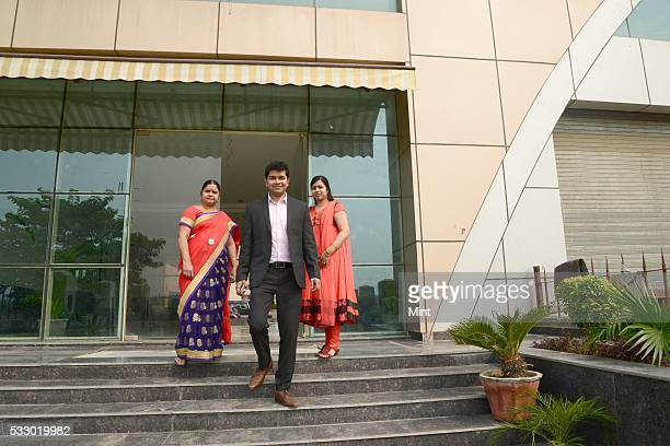 Chetan Verma hunting for a house at the city's sector 108 with his mother Usha Verma and wife Babita Soni coming out after talking to a developer...