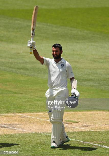 Cheteshwar Pujara celebrates his century during day two of the Third Test match in the series between Australia and India at Melbourne Cricket Ground...