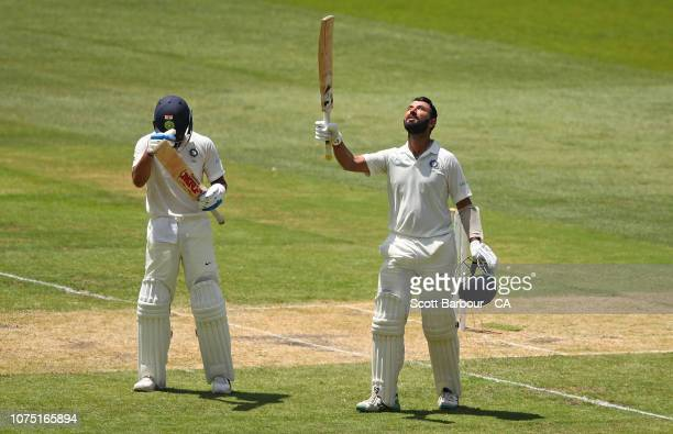 Cheteshwar Pujara is congratulated by Virat Kohli as he celebrates his century during day two of the Third Test match in the series between Australia...