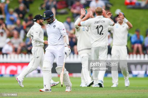 Cheteshwar Pujara leaves the field after being dismissed during day one of the First Test match between New Zealand and India at Basin Reserve on...