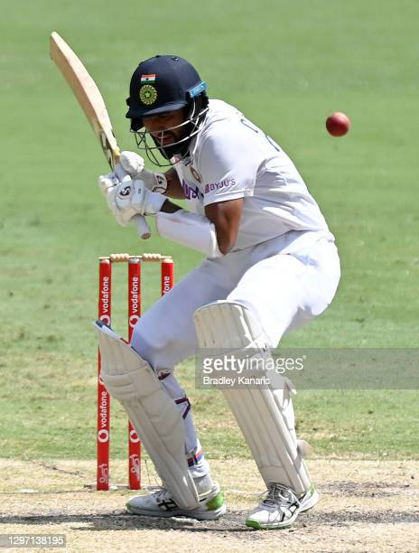 Cheteshwar Pujara of India avoids a bouncer during day five of the 4th Test Match in the series between Australia and India at The Gabba on January...