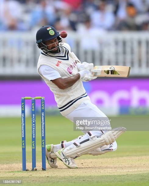 Cheteshwar Pujara of India avoids a Mark Wood bouncer during the fourth day of the 2nd LV= Test match between England and India at Lord's Cricket...