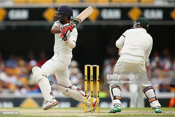 Cheteshwar Pujara of India bats during day four of the 2nd Test match between Australia and India at The Gabba on December 20 2014 in Brisbane...